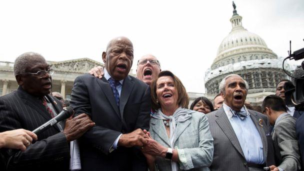 PHOTO: Minority James Clyburn, Rep. John Lewis, Rep. Joseph Crowley, House Minority Leader Nancy Pelosi and Rep. Charles Rangel, sing