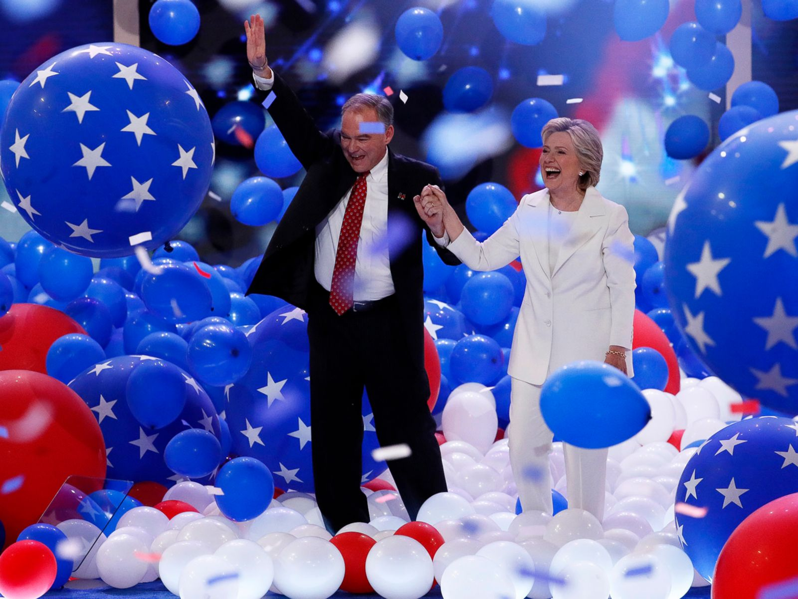 PHOTO: Democratic presidential nominee Hillary Clinton and Democratic vice presidential nominee Sen. Tim Kaine, walk through the falling balloons during the final day of the Democratic National Convention in Philadelphia, July 28, 2016.
