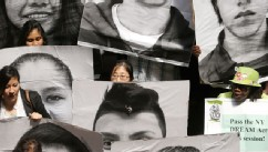 PHOTO: Supporters of the New York DREAM Act hold photos of undocumented students who are not eligible for college tuition assistance during a rally at the Capitol on Tuesday, May 21, 2013, in Albany, N.Y. The state Assembly today is expected to pass DREAM