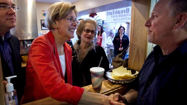 PHOTO: Democratic candidate for U.S. Senate Elizabeth Warren, center, greets Bruce Trotto, of Shrewsbury, Mass., right, during a campaign stop at the diner in Shrewsbury, April 29, 2012.