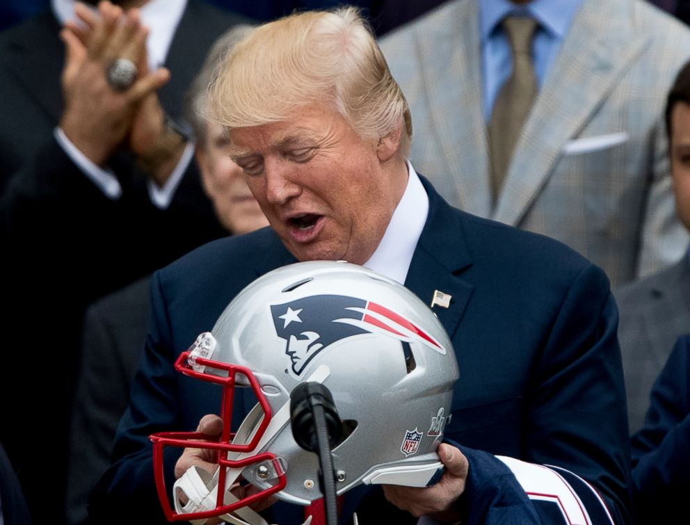 PHOTO: President Donald Trump is presented with a New England Patriots football helmet by Patriots head coach Bill Belichick and New England Patriots owner Robert Kraft during a ceremony at the White House in Washington, Wednesday, April 19, 2017.