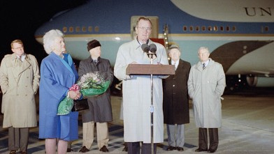PHOTO: U.S. President George H. Bush, accompanied by first lady Barbara, makes farewell remarks before departing Andrews Air Force Base, Md., Monday, Dec. 30, 1991 for a trip to Australia and Asia.