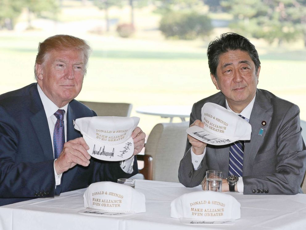 PHOTO: U.S. President Donald Trump (L) meets Japans Prime Minister Shinzo Abe at Kasumigaseki Country Club to play golf in Saitama Prefecture on Nov. 5, 2017. Trump came to Japan for the first time as a President, and will stay in Japan until Nov. 7th.