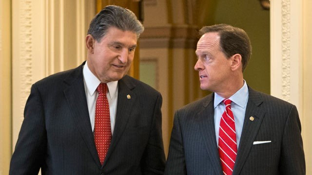 PHOTO: Sen. Joe Manchin, D-W.Va., left, and Sen. Patrick Toomey, R-Pa. arrive for a news conference on Capitol Hill in Washington, April 10, 2013, to announce that they have reached a bipartisan deal on expanding background checks to more gun buyers.