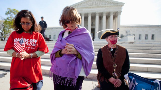 PHOTO: Protestors pray in front the Court in Washington, March 28, 2012, as the court concludes three days of hearing arguments on the constitutionality of President Barack Obamas health care overhaul.