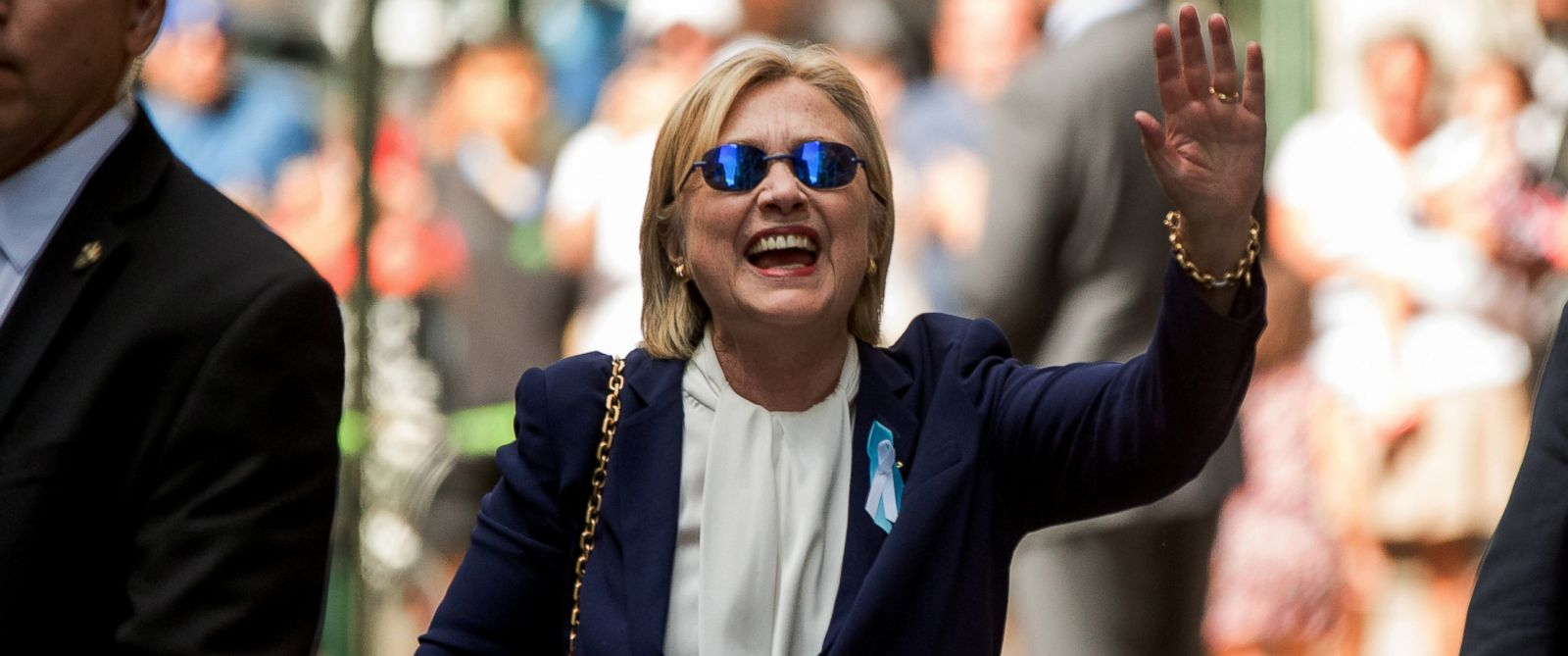 PHOTO: Democratic presidential candidate Hillary Clinton waves after leaving an apartment building in New York City, Sept. 11, 2016.