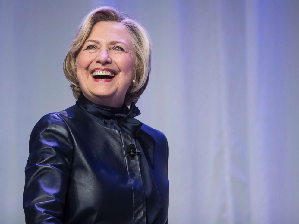 PHOTO: Hillary Clinton smiles as she walks on stage for a book tour event in Vancouver, B.C., on Wednesday December 13, 2017.