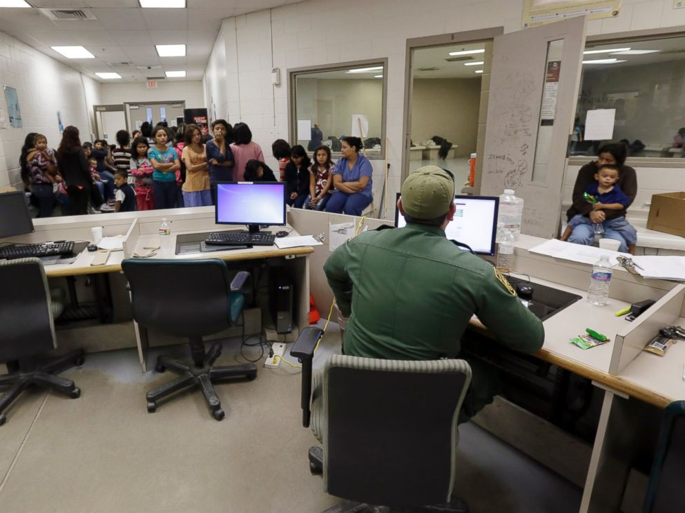 U.S. Customs and Border Protection agents work at a processing facility, June 18, 2014, in Brownsville, Texas.