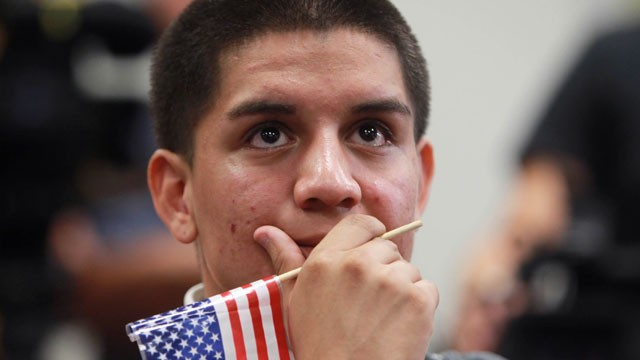 PHOTO: Jose Machado, a student of Nicaraguan descent, reacts during an announcement on the new U.S. immigration law during a news conference at the downtown Wolfson Campus of Miami-Dade College on Friday, June 15, 2012, in Miami.