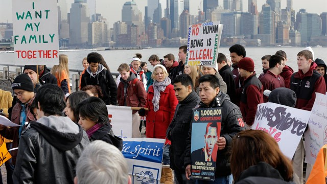 PHOTO: With the New York skyline behind, a group of immigrant rights advocates gather near Ellis Island Wednesday, Feb. 13, 2013, in Liberty State Park, Jersey City, N.J.