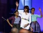 "PHOTO: First lady Michelle Obama, center, and daughters Sasha, left, and Malia, right, react during the ""Kids Inaugural: Our Children. Our Future."" event in Washington, Saturday, Jan. 19, 2013."