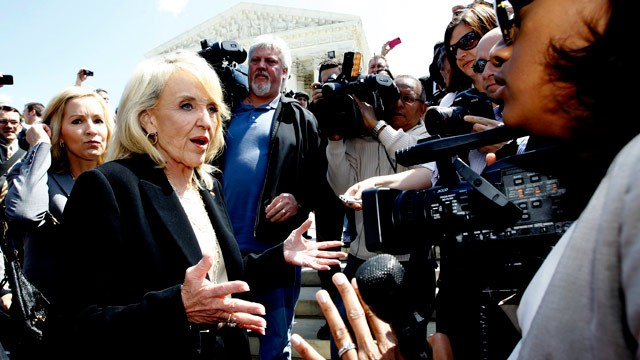 "PHOTO: Arizona Gov. Jan Brewer speaks to reporters outside the Supreme Court in Washington, Wednesday, April 25, 2012, after the courts hearing on Arizonas ""show me your papers"" immigration law."