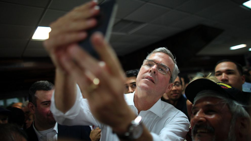 PHOTO: Former Florida Gov. Jeb Bush takes a selfie with a supporters phone after holding a town hall meeting with Puerto Ricos Republican Party in Bayamon, Puerto Rico, April 28, 2015.