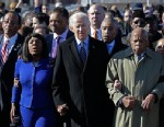 PHOTO: Vice President Joe Biden, center, leads a group across the Edmund Pettus Bridge in Selma, Ala., Sunday, March 3, 2013.