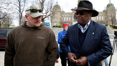 "PHOTO: Former Godfather's Pizza CEO Herman Cain talks with Samuel ""Joe the Plumber"" Wurzelbacher, left, before speaking at a tea party rally in this  April 16, 2011 file photo at the Statehouse in Des Moines, Iowa."