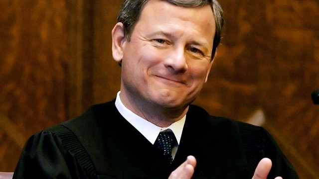 PHOTO: U.S. Supreme Court Chief Justice John G. Roberts, Jr., applauds at the opening celebration of the Centennial  of the U.S. Courthouse in Providence, R.I., Feb. 12, 2008.