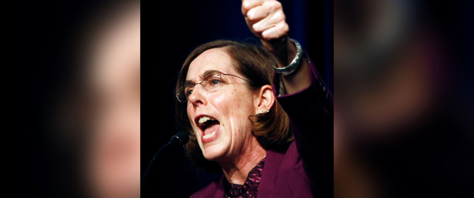 PHOTO: In this Nov. 6, 2012 file photo, Oregon Democratic Secretary of State Kate Brown celebrates at the podium after winning her race at Democratic headquarters in Portland, Ore.
