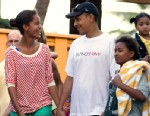 PHOTO: President Barack Obama holds hands with his daughters Malia, left, and Sasha, right, as they leave Sea Life Park, a marine wildlife park, with family friends in Waimanalo, Hawaii, Dec. 27, 2011.