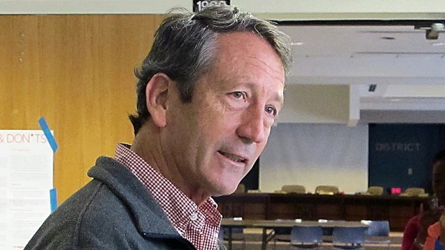 PHOTO: Former South Carolina Gov. Mark Sanford speaks with reporters, March 19, 2013, at a polling place in Charleston, S.C.