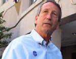 PHOTO: Former South Carolina Gov. Mark Sanford answers questions from reporters after voting in C
