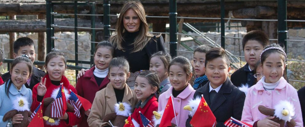 PHOTO: U.S. first lady Melania Trump poses for photos with Chinese children holding flags and the bald eagle dolls near the panda enclosure at a zoo in Beijing, China, Friday, Nov. 10, 2017.