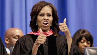 PHOTO: First lady Michelle Obama gives a thumbs up in response to students' cheers after she handed out diplomas to graduates of Martin Luther King, Jr. Academic Magnet High School on Saturday, May 18, 2013, in Nashville, Tenn.