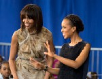 PHOTO: First lady Michelle Obama and actress Kerry Washington smile as they arrive for a performance at Savoy Elementary School in Washington, May 24, 2013.