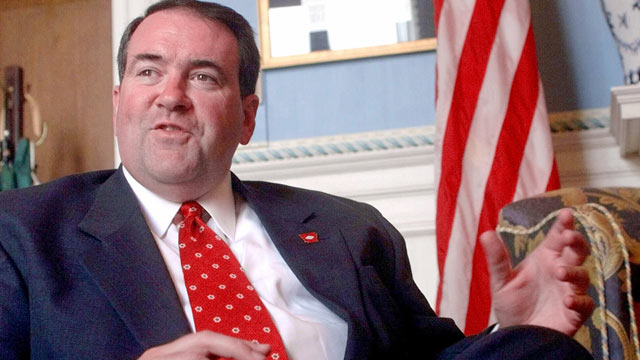 PHOTO: Mike Huckabee speaks with reporters in his office at the Capitol in Little Rock, Ark., July 11, 2001.