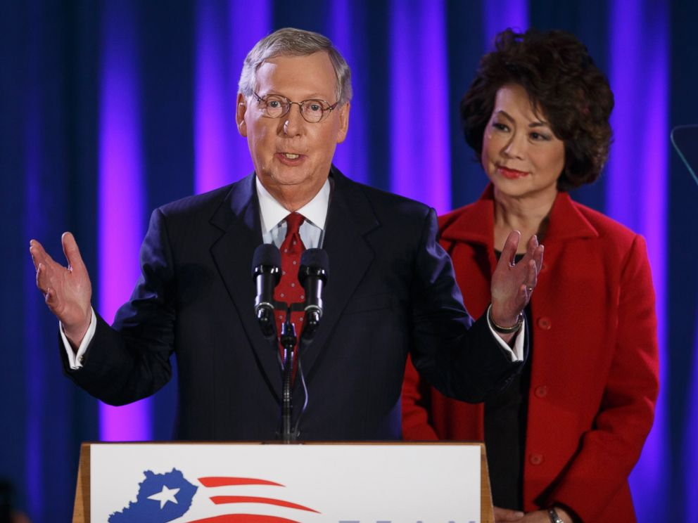 PHOTO: Senate Minority Leader Mitch McConnell of Ky., joined by his wife, former Labor Secretary Elaine Chao, celebrates with his supporters at an election night party in Louisville, Ky., Nov. 4, 2014.