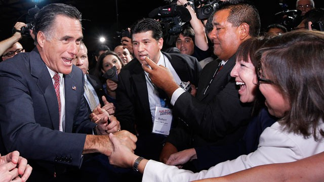 PHOTO: Republican presidential candidate Mitt Romney, greets attendees at the NALEO conference in Orlando, Fla., June 21, 2012.