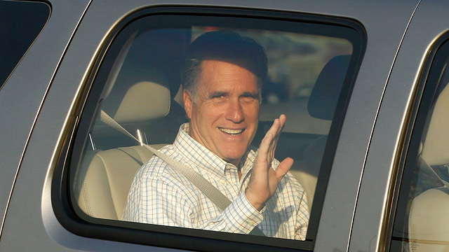 PHOTO: Republican Presidential candidate Mitt Romney waves as he arrives at the Utah Olympic Park for a private dinner during a donors conference in Park City, Utah, Friday, June 22, 2012.