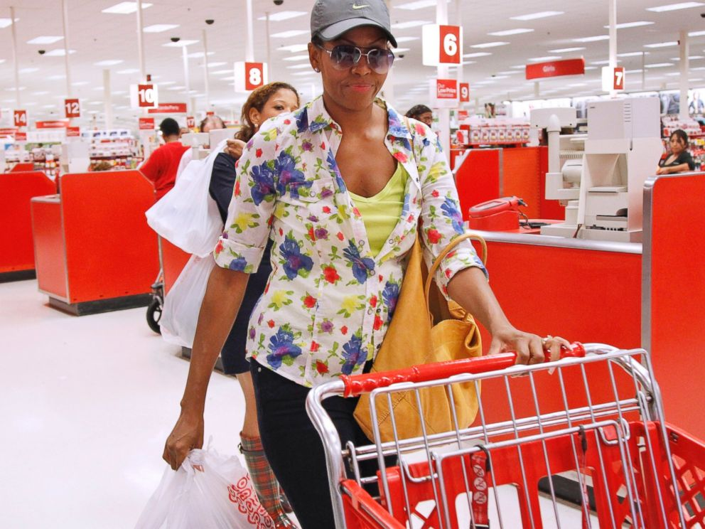 PHOTO: First lady Michelle Obama, wearing a hat and sunglasses, stands in line at a Target department store in Alexandria, Va., Sept. 29, 2011.