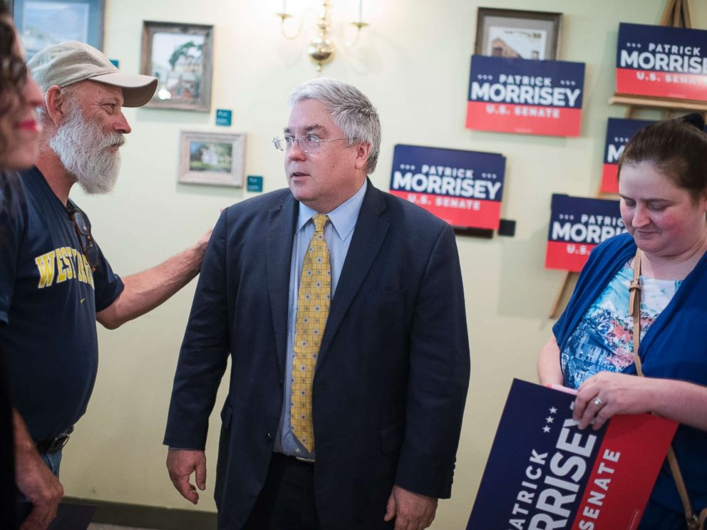 PHOTO: West Virginia Attorney General Patrick Morrisey talks with guests during an event in Harpers Ferry, W.Va., on July 10, 2017, where he announced he will run for the Senate in 2018.