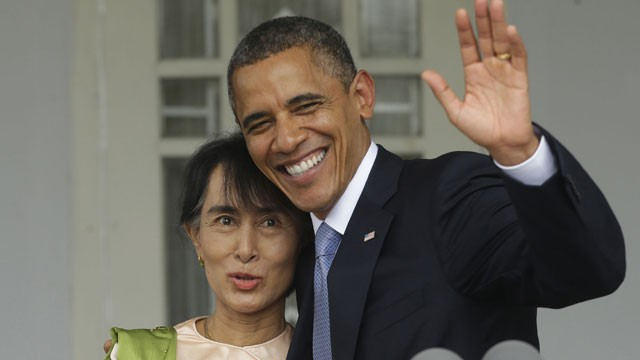 PHOTO: U.S. President Barack Obama, right, waves as he embraces Myanmar democracy activist Aung San Suu Kyi after addressing members of the media at Suu Kyi's residence in Yangon, Myanmar, Monday, Nov. 19, 2012.