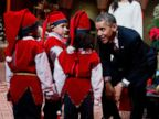 PHOTO: President Barack Obama greets children dressed like elves at the National Building Museum in Washington, Sunday, Dec. 15, 2013.