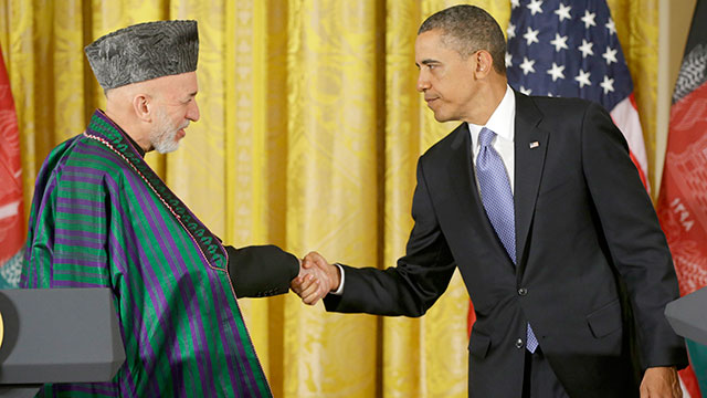 President Barack Obama shakes hands with Afghan President Hamid Karzai at the conclusion of their joint news conference in the East Room of the White House in Washington, Jan. 11, 2013.