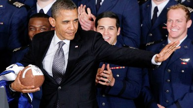 PHOTO: President Barack Obama strikes the Heisman pose after he awarded the Commander-in-Chief Trophy to the Air Force Academy football team, April 23, 2012, in the East Room of the White House in Washington.