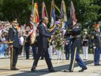 PHOTO: President Barack Obama, accompanied by Maj. Gen. Jeffrey S. Buchanan, left, and Sgt. 1st Class John C. Wirth, lays a wreath at the Tomb of the Unknowns, on Memorial Day, May 25, 2015, at Arlington National Cemetery in Arlington, Va.