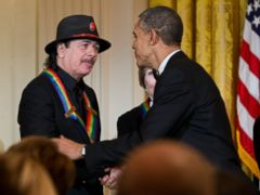PHOTO: President Barack Obama, right, congratulates 2013 Kennedy Center Honors recipient, Carlos Santana, during a reception honoring the 2013 Kennedy Center Honors recipients, in the East Room of the White House in Washington, Sunday, Dec. 8, 2013.