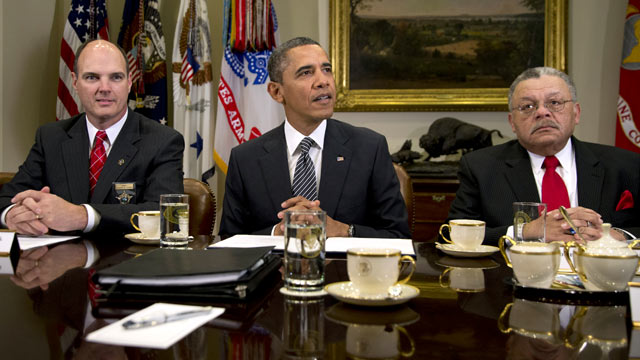 PHOTO: Hennepin County Minnesota Sheriff Richard W. Stanek, left, and Charles H. Ramsey Police Commissioner of the Philadelphia Police Department, right, listen to President Barack Obama in the Roosevelt Room of the White House, Jan. 28, 2013, in Washingt
