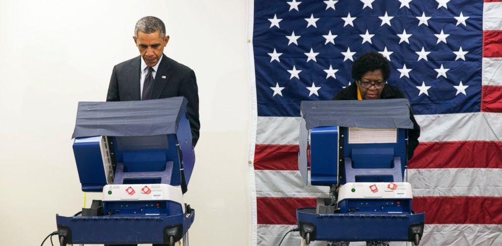 PHOTO: President Barack Obama votes early for the midterm election at the Dr. Martin Luther King Community Service Center, Oct. 20, 2014, in Chicago.