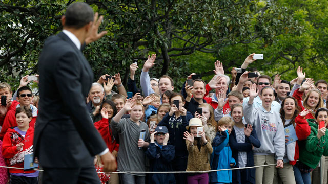 PHOTO: President Barack Obama waves to visitors as he walks on the South Lawn of the White House in Washington, March 30, 2012, as he travels to Vermont and Maine for campaign fundraising events.