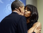 PHOTO: President Barack Obama kisses first lady Michelle Obama as they speak to supporters and donors at an inaugural reception for the 57th Presidential Inauguration at The National Building Museum in Washington, Sunday, Jan. 20, 2013.