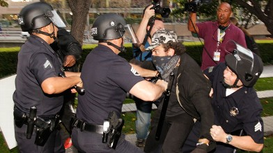 Los Angeles police officers struggle to arrest an unidentified police provocateur in Los Angeles on Nov. 17, 2011.