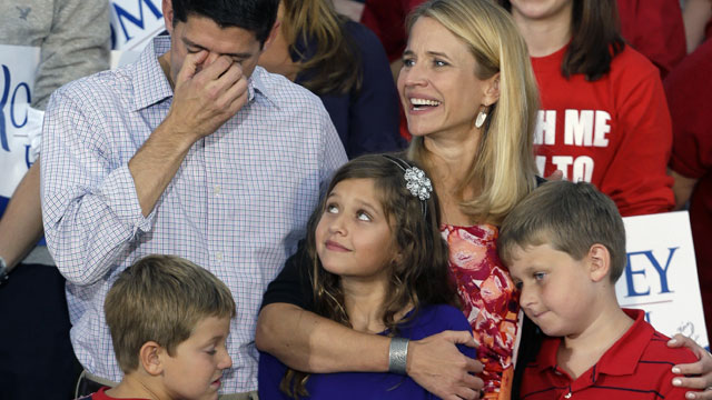 PHOTO: Republican vice presidential running mate Rep. Paul Ryan, R-Wis., left, fights back tears with his family, wife Janna, daughter Liza with sons Charles and Sam, at his side during a welcome home rally, Sunday, Aug. 12, 2012 in Waukesha, Wis.