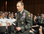 PHOTO: Gen. David Petraeus walks past a seated Paula Broadwell, rear right, as he arrives to appear before the Senate Intelligence Committee during a hearing on his nomination to be Director of the Central Intelligence Agency on Capitol Hill in Washington