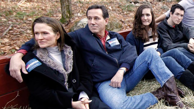 PHOTO: Republican presidential candidate Rick Santorum, second from left, takes a hay ride with his wife Karen, left, his daughter Sarah Maria, his son Daniel, respectively third and forth form left, and other patrons in Candia, N.H., Nov. 26, 2011.