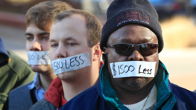 PHOTO: Protesters hold a silent protest in Lansing, Mich., Dec. 12, 2012, a day after thousands of protesters rallied on the grounds as lawmakers pushed final versions of right-to-work legislation.