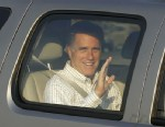 PHOTO:Republican Presidential candidate Mitt Romney waves as he arrives at the Utah Olympic Park for a private dinner during a donors conference in Park City, Utah, Friday, June 22, 2012.