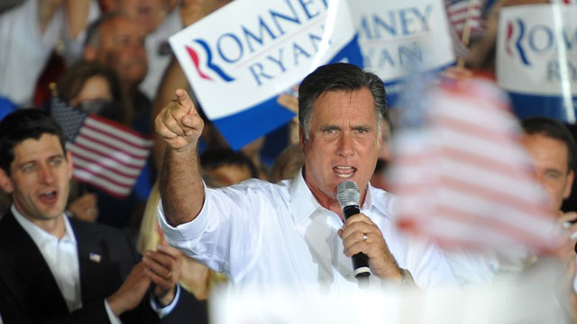 PHOTO: In this photo provided by the U.S. Coast Guard, Republican Presidential candidate Mitt Romney, right, speaks during a campaign rally in Manassas, Va., Saturday, Aug. 11, 2012.